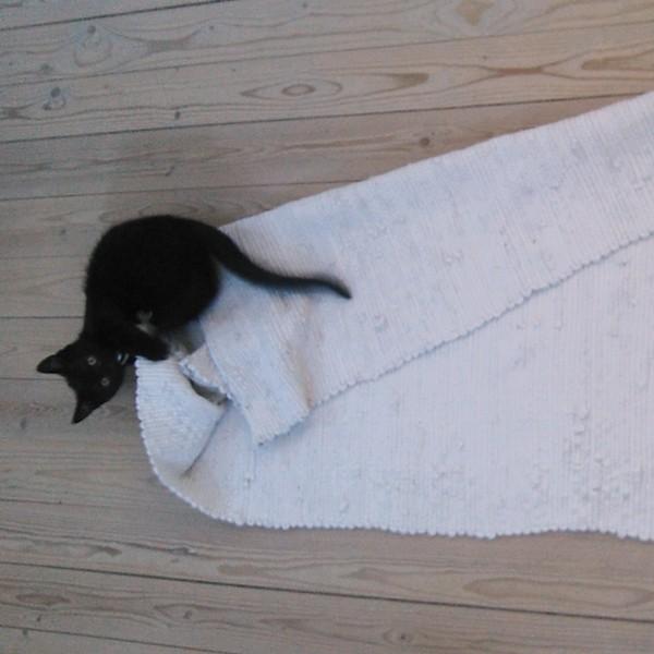 omplacering af kludetæppe